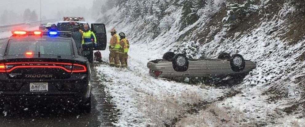 PHOTO: A car slid off the highway and flipped over in snowy conditions near Helena, Mont., on Saturday, Sept. 28, 2019. No one was seriously injured.