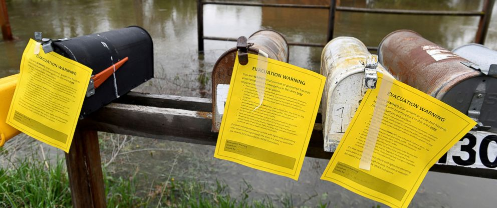 PHOTO: Evacuation warning notices hang on a row of mailboxes in front of a flooded area Monday, May 7, 2018, on the outskirts of Missoula, Mont.