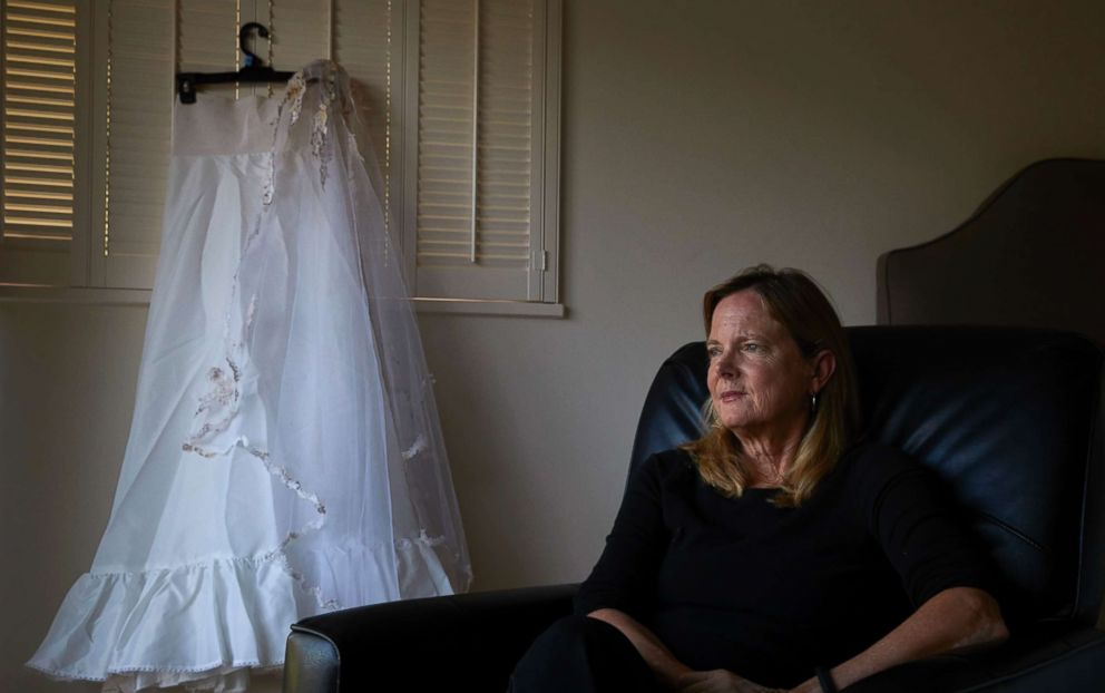 PHOTO: Karen McDonald, whose home was swept away in a mudslide, poses for photos with her wedding veil and the underskirt to her wedding dress she had worn 35 years earlier at her wedding, in Santa Barbara, Calif., April 11, 2018.