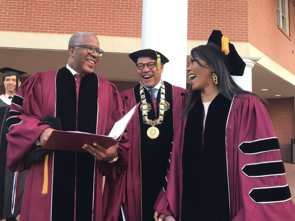 PHOTO: Robert F. Smith, left, laughs with David Thomas, center, and actress Angela Bassett at Morehouse College, May 19, 2019, in Atlanta.