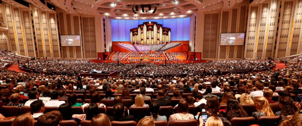 In this Sept. 30, 2017, file photo, people attend the morning session of the two-day Mormon church conference in Salt Lake City.