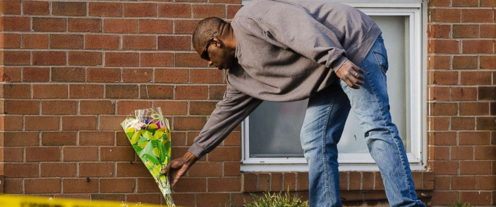 PHOTO: A man places flowers at the Robert Morris Apartments in Morrisville, Pa., Feb. 26, 2019.