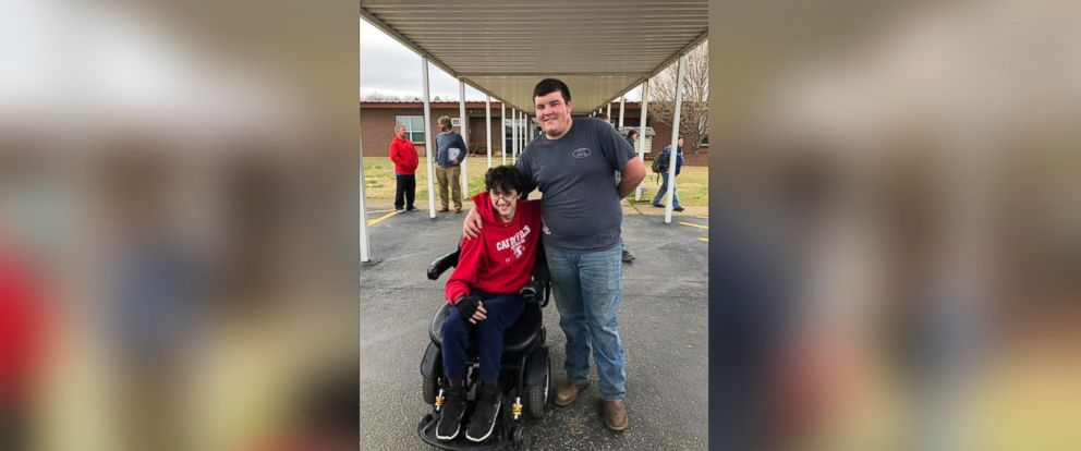 PHOTO: Brandon Qualls and Tanner Wilson pose for a picture outside Caddo Hills High School, Norman Ark., Feb. 26, 2018.