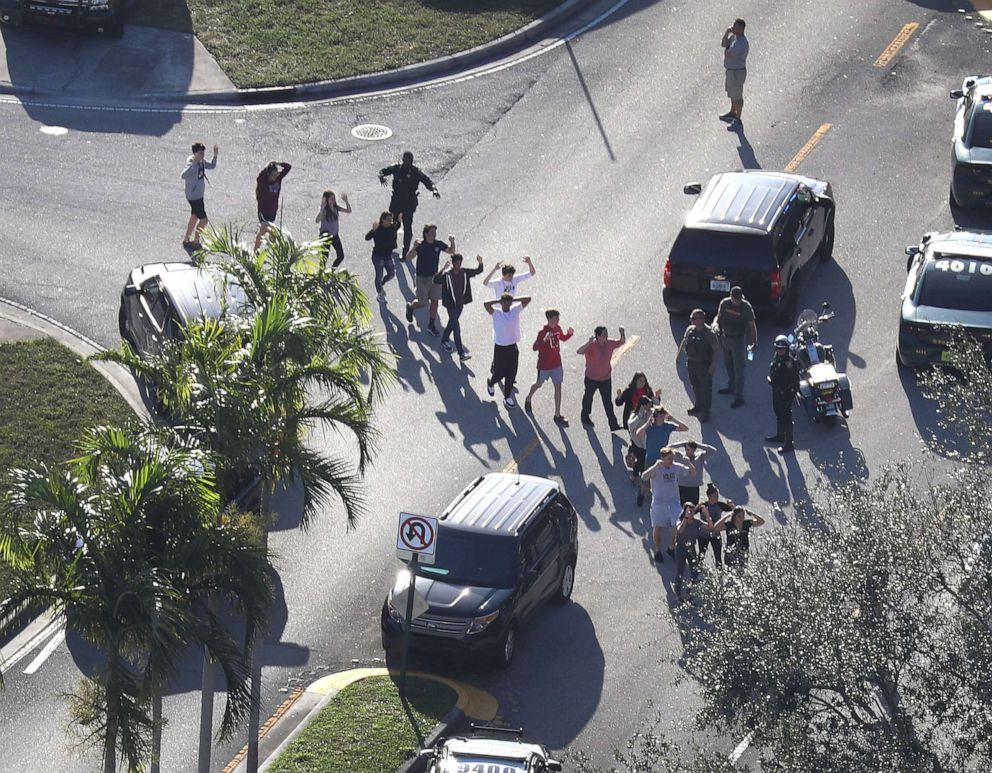 PHOTO: People are brought out of the Marjory Stoneman Douglas High School after a shooting at the school that killed and injured multiple people, Feb. 14, 2018, in Parkland, Fla.