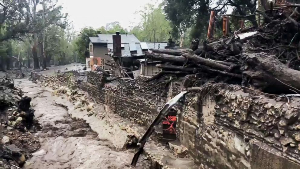 This photo from video provided by the Santa Barbara County Fire Department shows Montecito Creek flowing alongside debris left over from January mudslides in Montecito, Calif., March 21, 2017.