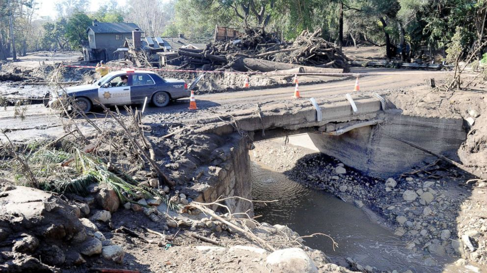 Police drive amid the devastation of a mudslide on East Valley Road in Montecito, Calif., on Jan. 11, 2018.