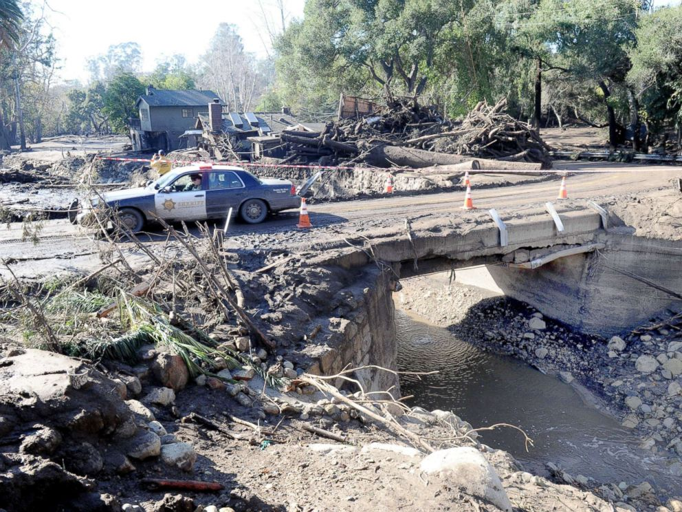 PHOTO: Police drive amid the devastation of a mudslide on East Valley Road in Montecito, Calif., on Jan. 11, 2018.