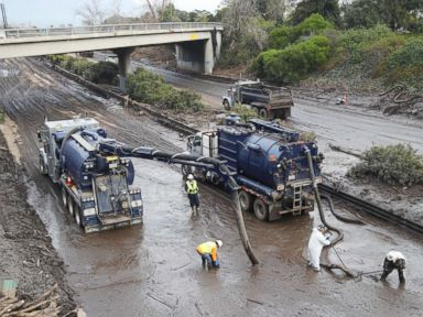 PHOTO: Workers use vacuum trucks to clear the muck left by the mudslide from Highway 101 in Montecito, Calif., Jan. 15, 2018.