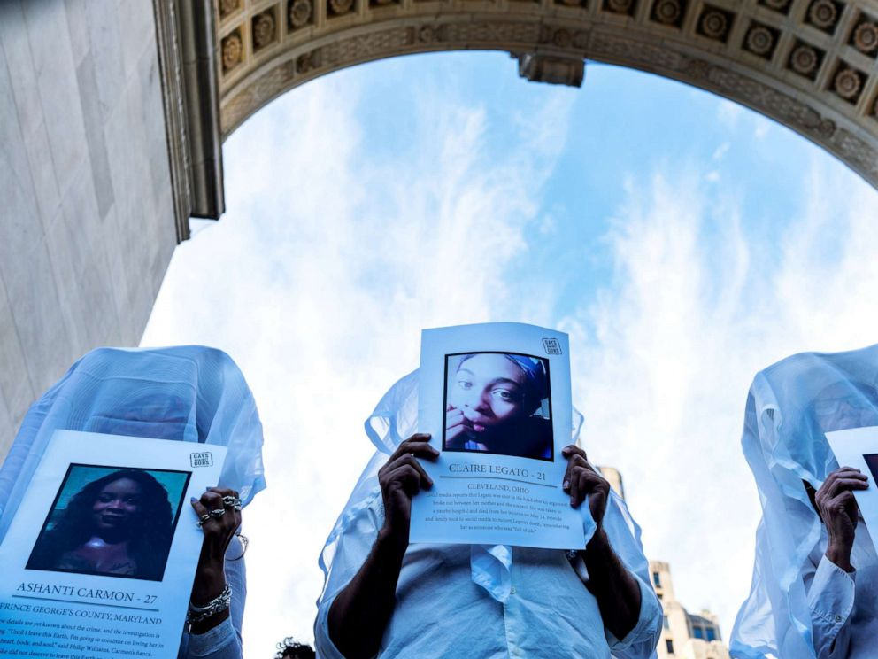 PHOTO: Transgender rights activists hold pictures of transgender women who were killed this year as they protest the recent killings of three transgender women during a rally at Washington Square Park in New York, May 24, 2019.