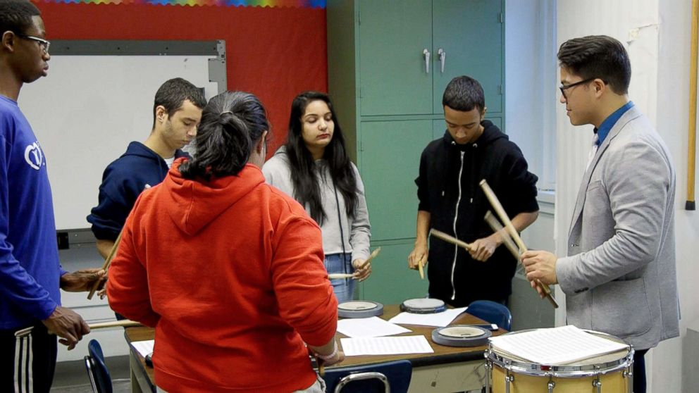 PHOTO: Brandon Ilaw gives a percussion lesson at Port Richmond High School in Staten Island, NY.