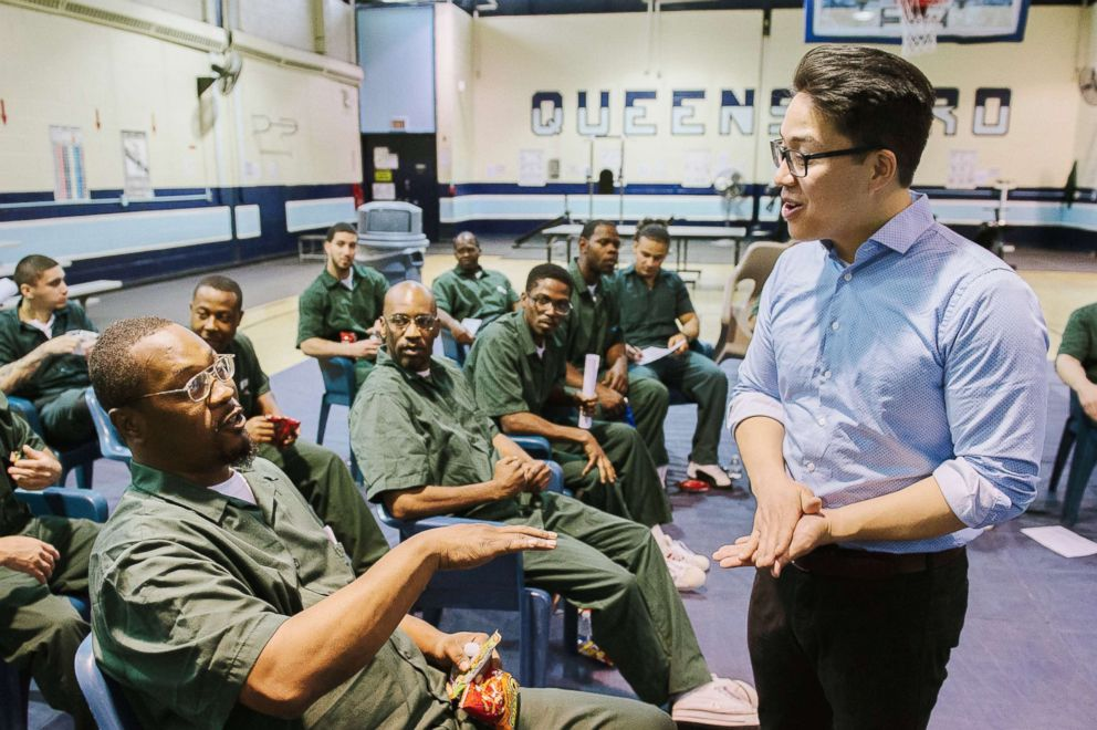 PHOTO: Ensemble Connect fellow Brandon Ilaw speaking with inmates at Queensboro Correctional Facility.