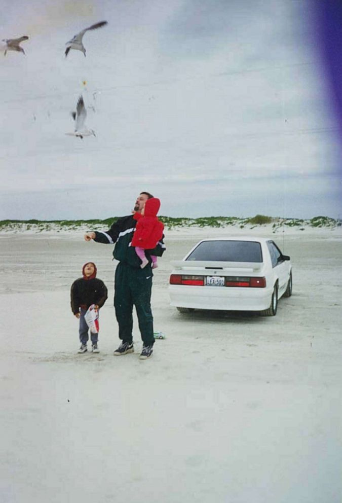 PHOTO: Wesley Ryan is seen here with his beloved 1993 white Ford Mustang GT and his family. He sold the car in 2004 to pay for his wifes medical bills as she battled cancer.