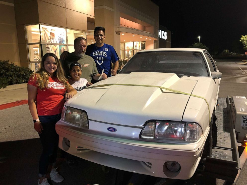 PHOTO: Wesley Ryan and Laura and their children Jake and Jeni of San Antonio, Texas, pose with his beloved 1993 white Ford Mustang GT in 2018 after Jake and Jeni bought the car back for their dad off Craigslist.