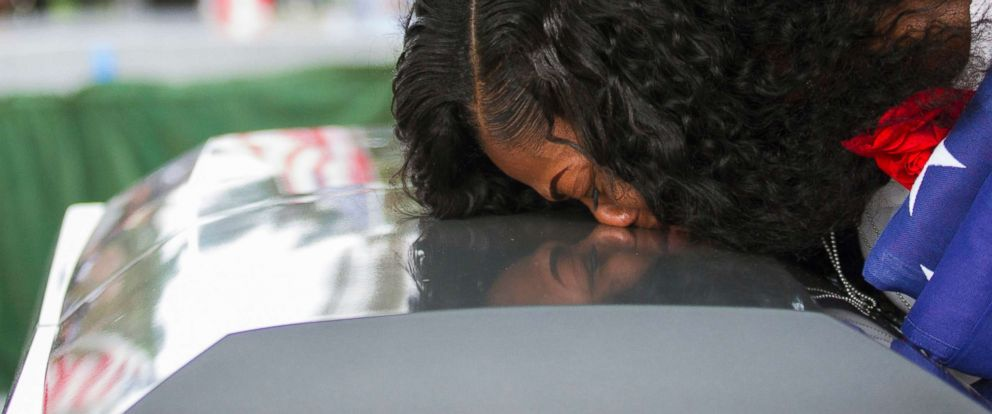 PHOTO: Myeshia Johnson kisses the casket of her husband, Sgt. La David Johnson, during his burial service at Fred Hunters Hollywood Memorial Gardens, Oct. 21, 2017, in Hollywood, Fla.