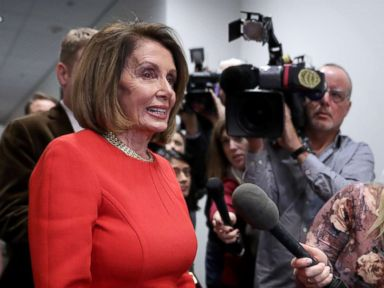 PHOTO: House Minority Leader Nancy Pelosi talks to journalists before heading into a Democratic caucus meeting at the U.S. Capitol Visitors Center, Nov. 14, 2018, in Washington, DC.