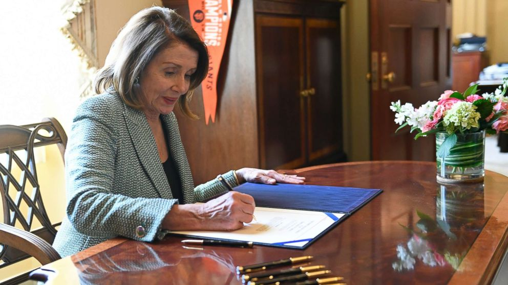 House Speaker Nancy Pelosi of Calif., signs H.J. Res 46, a disapproval resolution that blocks President Trump's national emergency declaration, on Capitol Hill in Washington, March 14, 2019.