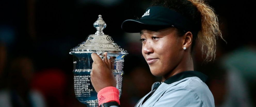 PHOTO: Naomi Osaka, of Japan, holds the trophy after defeating Serena Williams in the womens final of the U.S. Open tennis tournament, Saturday, Sept. 8, 2018, in New York.