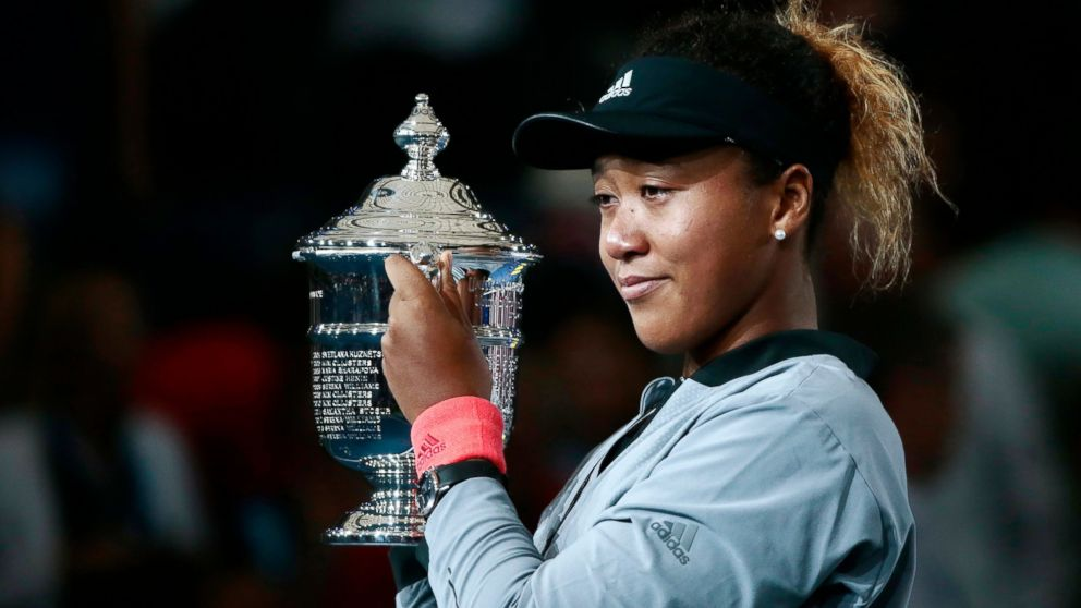 Naomi Osaka, of Japan, holds the trophy after defeating Serena Williams in the women's final of the U.S. Open tennis tournament, Saturday, Sept. 8, 2018, in New York.