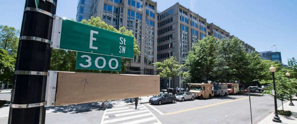 PHOTO: A covered street sign is seen outside of the NASA Headquarters building the day before a street renaming ceremony, June 11, 2019, in Washington, D.C.