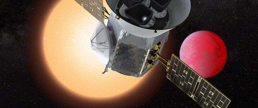 PHOTO: An artists depiction shows NASAs Transiting Exoplanet Survey Satellite in front of a lava planet orbiting its host star.