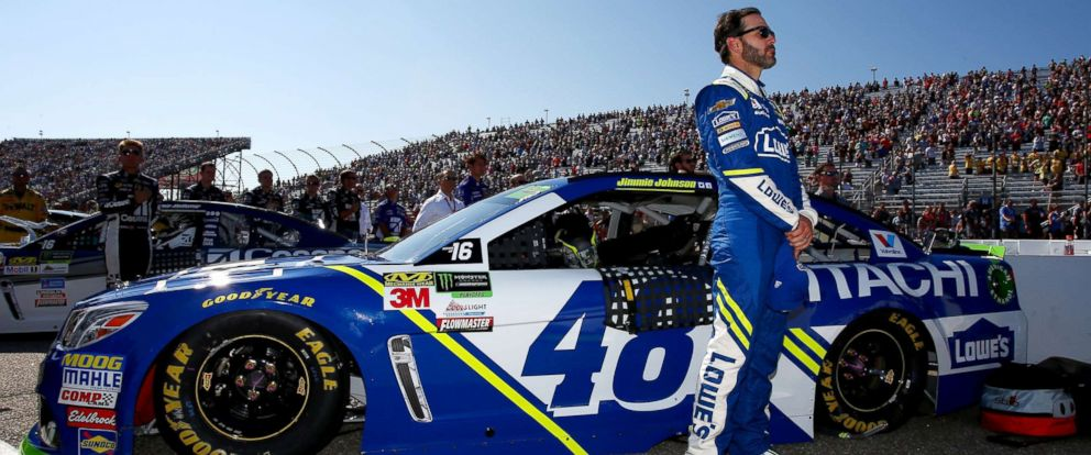 PHOTO: Jimmie Johnson, driver of the #48 Lowes Chevrolet, stands for the national anthem during pre-race ceremonies for the Monster Energy NASCAR Cup Series ISM Connect 300 at New Hampshire Motor Speedway, Sept. 24, 2017, in Loudon, New Hampshire.