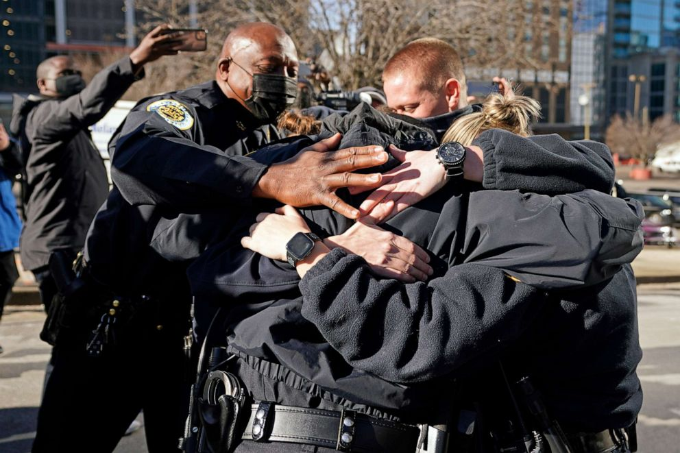 PHOTO: Nashville Police Chief John Drake, left, joins a group of police officers as they embrace after speaking at a news conference, Dec. 27, 2020, in Nashville, Tenn.