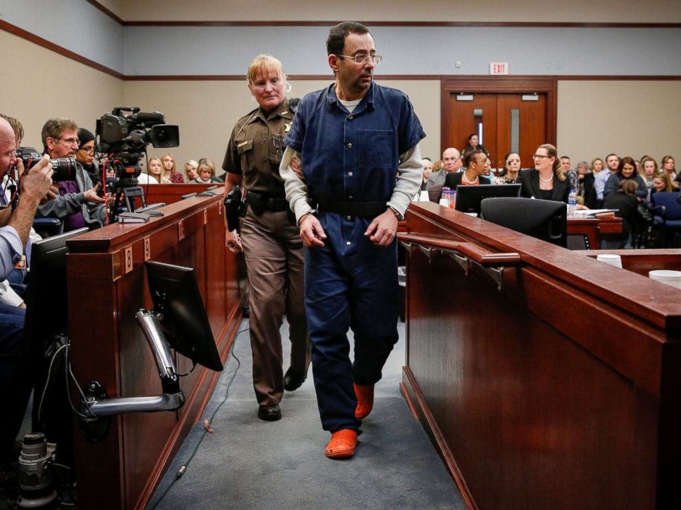 PHOTO: Larry Nassar, a former team USA Gymnastics doctor who pleaded guilty in November 2017 to sexual assault charges, is escorted by a court officer during his sentencing hearing in Lansing, Mich., Jan. 17, 2018.