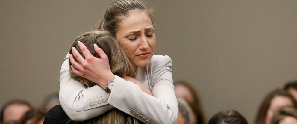 PHOTO: Victim Emily Morales is hugged after speaking at the sentencing hearing for Larry Nassar in Lansing, Mich., Jan. 23, 2018.
