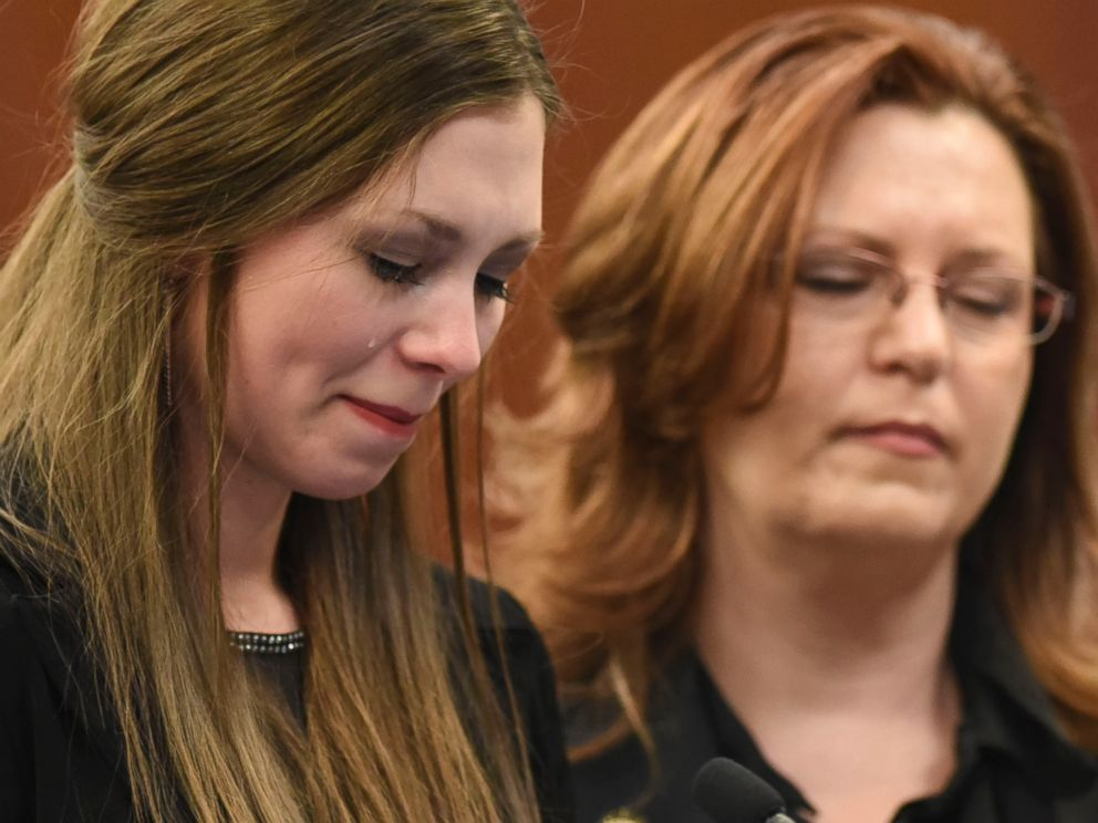 Dancer Jessica Smith and her mother Kimberly listen as Circuit Judge Rosemarie Aquilina speaks during the third day of victim impact statements in the trial of doctor Larry Nassar, in Lansing, Mich., Jan. 18, 2018.
