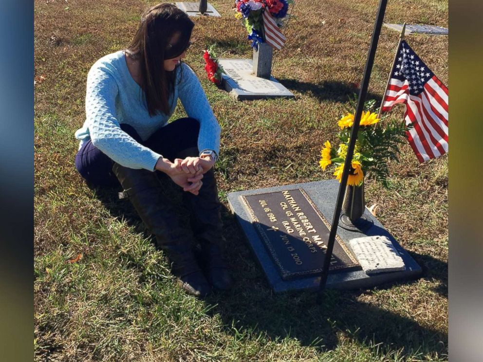 PHOTO: Kylynn Maxwell sits at her late husband Marine Corporal Nathan Maxwells grave site.