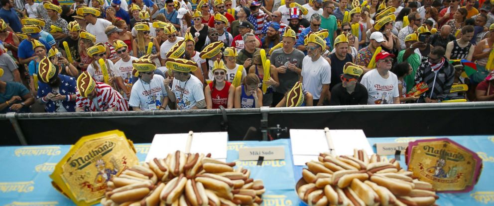 PHOTO: People attend the Annual Nathans Hot Dog Eating Contest on July 4, 2018 in the Coney Island neighborhood of the Brooklyn borough of New York City.
