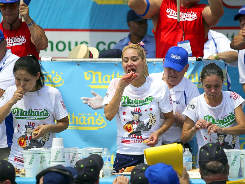 PHOTO: Winner Miki Sudo (C) competes in the womens annual Nathans Hot Dog Eating Contest on July 4, 2018 in Coney Island.
