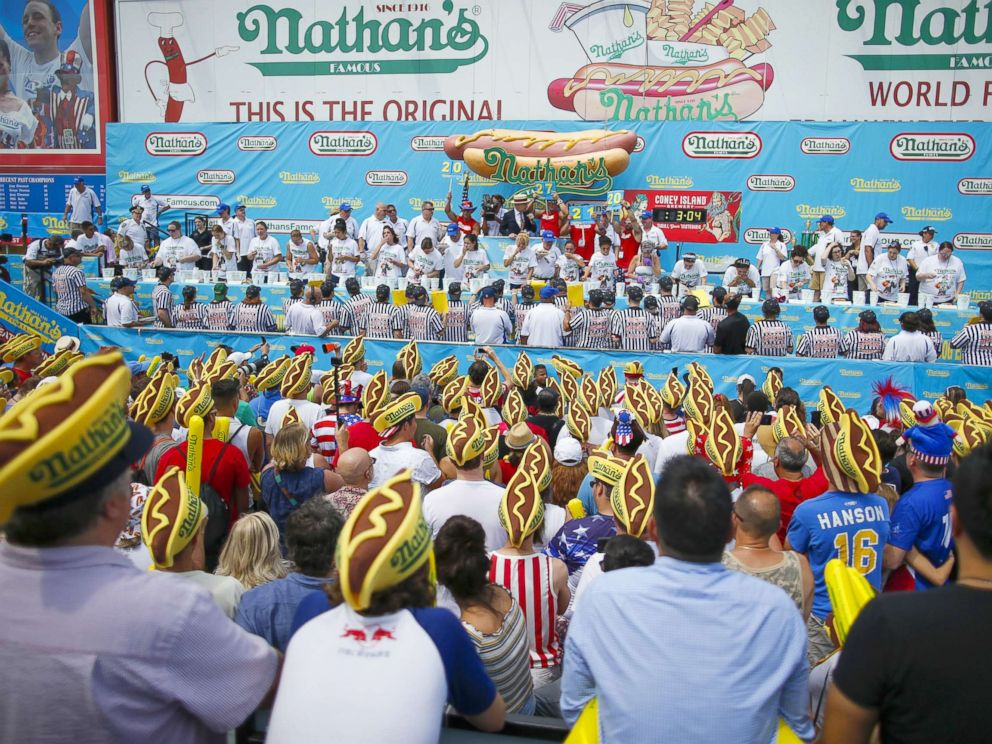 PHOTO: Women compete during the annual Nathans Hot Dog Eating Contest on July 4, 2018 in Coney Island.