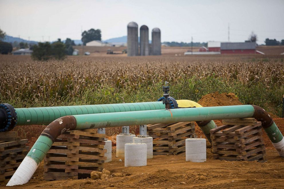 Transco pipelines used for transporting natural gas liquids lie exposed at the edge of a cornfield
