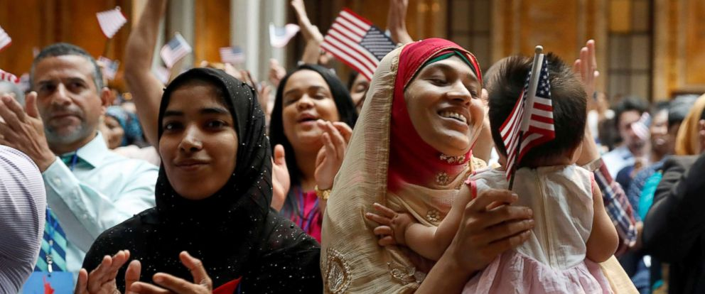 PHOTO: New citizens smile at a U.S. Citizenship and Immigration Services (USCIS) naturalization ceremony at the New York Public Library in Manhattan, New York, July 3, 2018.