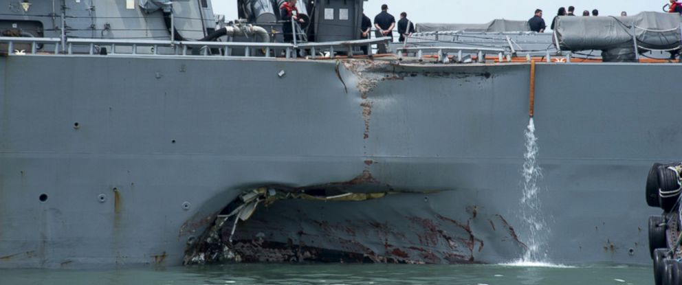 PHOTO: Damage to the portside is visible as the Guided-missile destroyer USS John S. McCain (DDG 56) steers towards Changi naval base in Singapore following a collision with the merchant vessel Alnic MC, Aug. 21, 2017.