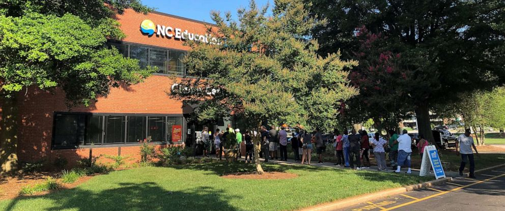 PHOTO: People line up outside the claims center at the headquarters of the N.C. Education Lottery in Raleigh, N.C., June 24, 2019.
