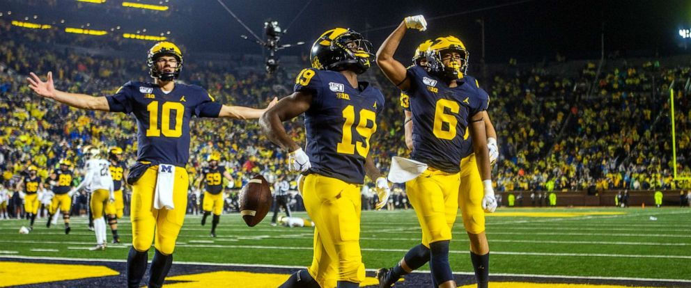 PHOTO: Michigan players celebrate a touchdown in the fourth quarter of an NCAA college football game against Notre Dame in Ann Arbor, Mich., Oct. 26, 2019.