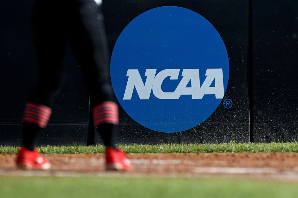 PHOTO: An athlete stands near an NCAA logo during a softball game in Beaumont, Texas, April 19, 2019.