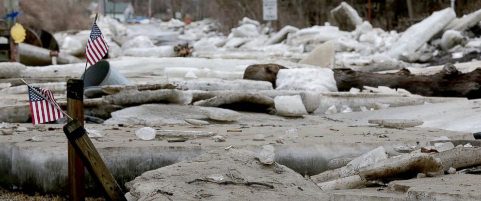 PHOTO: Thick ice slabs litter yards and roads in Fremont, Neb., Thursday, March 14, 2019, after the ice-covered Platte River flooded its banks.