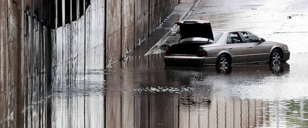 PHOTO: A car is stranded in floodwater in Grand Island, Neb., on Wednesday morning, Aug. 7, 2019, after a strong thunderstorm with high winds moved through the area with over an inch and a half of rain in a short period of time.