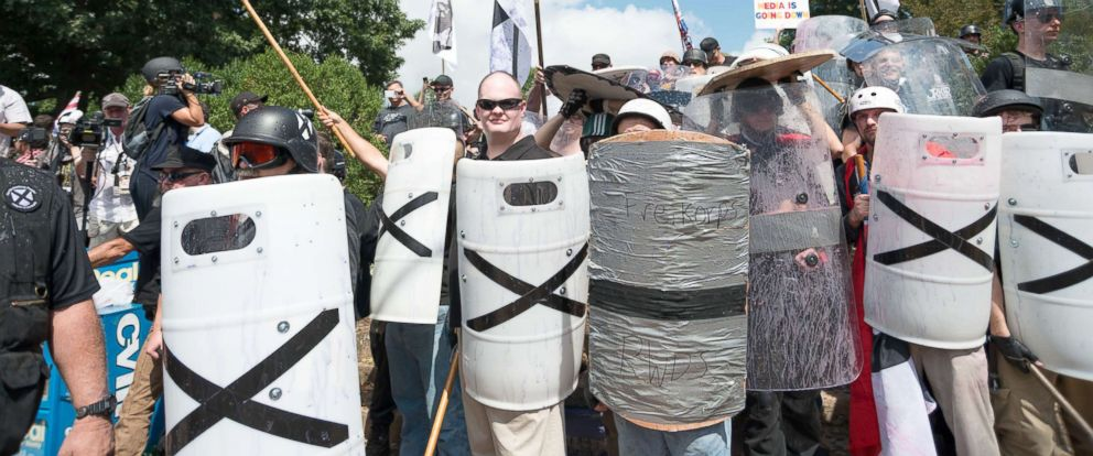 """PHOTO: Neo-Nazis, white supremacists and other alt-right factions scuffled with counter-demonstrators near Emancipation Park (Formerly """"Lee Park""""), Aug. 12, 2017, in downtown Charlottesville, Va."""