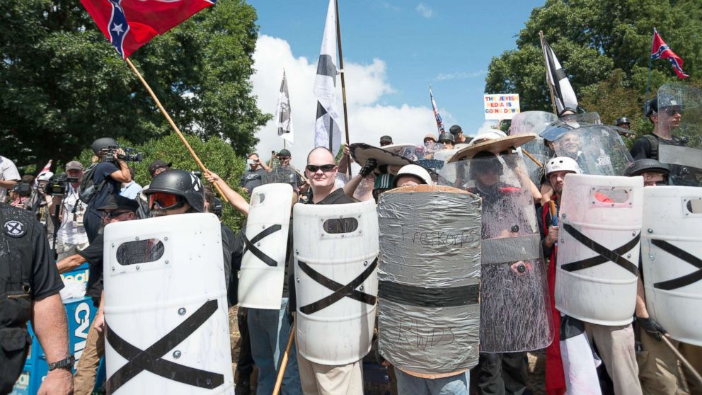 """Neo-Nazis, white supremacists and other alt-right factions scuffled with counter-demonstrators near Emancipation Park (Formerly """"Lee Park""""), Aug. 12, 2017, in downtown Charlottesville, Va."""