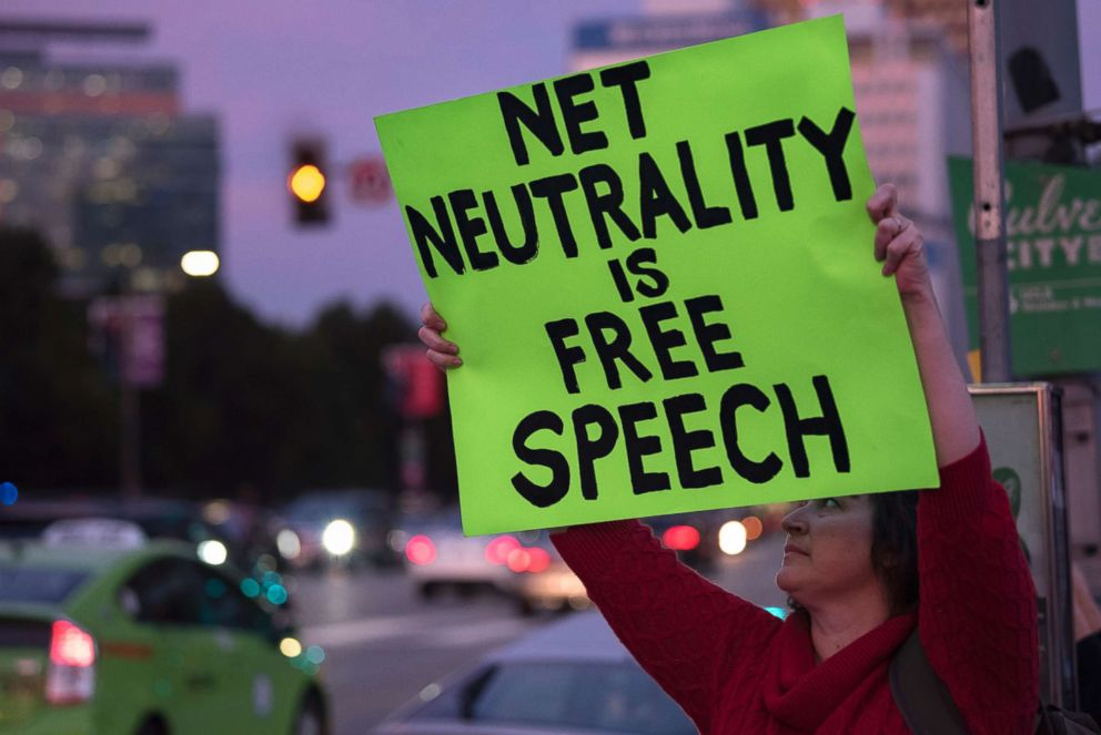 A supporter of net neutrality protests outside a Federal Building in Los Angeles, Nov. 28, 2017.