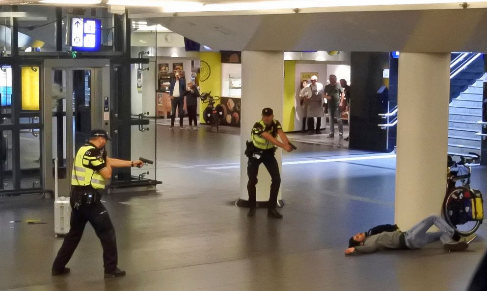 PHOTO: Dutch police officers point their guns at a wounded 19-year-old man who was shot by police after stabbing two people in the central railway station in Amsterdam, the Netherlands, Aug. 31, 2018.