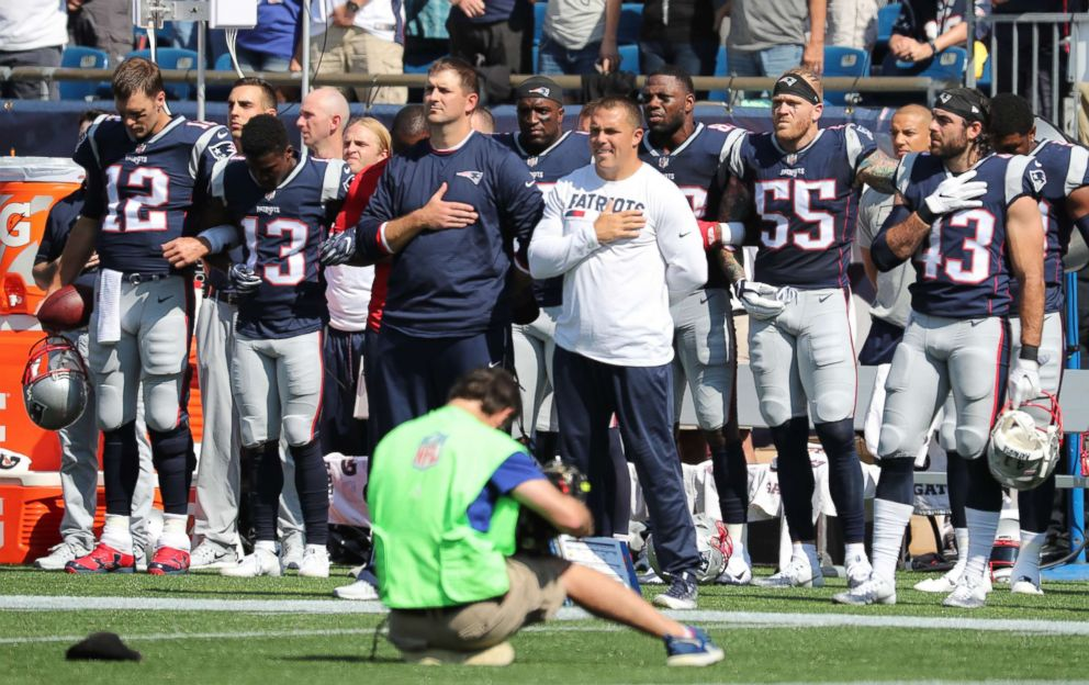 PHOTO: Patriots players during the national anthem before the start of a game against the Houston Texans at Gillette Stadium in Foxborough, Mass., Sept. 24, 2017.