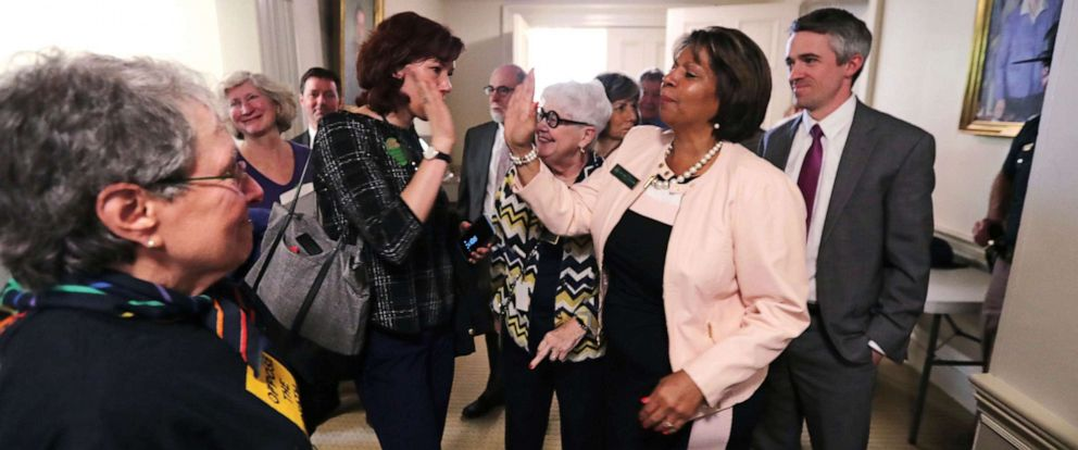 PHOTO: State Sen. Melanie Levesque, right, is congratulated following a vote on the death penalty at the State House in Concord, N.H., May 30, 2019.