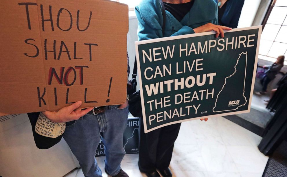 PHOTO: Protesters gather outside the Senate Chamber prior to a vote on the death penalty at the State House in Concord, N.H., Thursday, May 30, 2019.