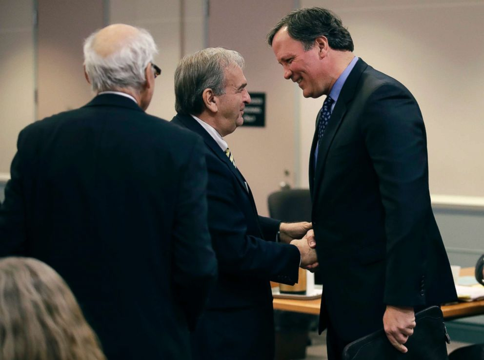 PHOTO: Attorney William Shaheen, who represents lottery winner Jane Doe, shakes hands with New Hampshire Lottery executive director Charles McIntyre, right, at the Jane Doe v. NH Lottery Commission case in Nashua, N.H., Feb. 13, 2018.