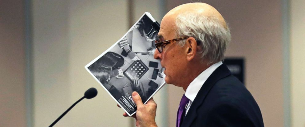 """PHOTO: Attorney Steven M. Gordon, who represents lottery winner """"Jane Doe"""", holds up an annual report from the New Hampshire Lottery during a hearing in the Jane Doe v. NH Lottery Commission case in Nashua, N.H., Feb. 13, 2018."""